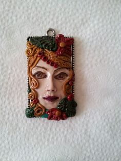 Polymer clay Face pendant by Bhavna Mistry