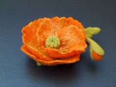 Orange Felted Flower Pin/Brooch.  It measures approximately 3 inches(8 cm) in diameter.