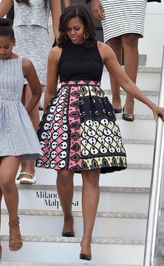 Pretty in Print de Michelle Obama's Best Looks  Another printed LBD for the first lady, who lands in Milan with daughters Sasha and Malia in three more summer-perfect frocks.