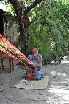 Weaver Tejedora Oaxaca Mexico  Master weaver Margarita Navarro Gomez weaves on her backstrap loom in Santo Tomas Jalieza, Oaxaca, Mexico