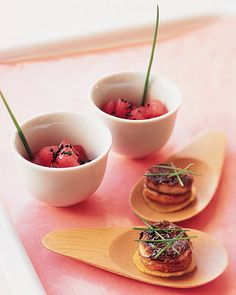 Mirin-laced tuna is served in sake cups, while bamboo spoons hold spicy snapper with slices of fried sweet plantains