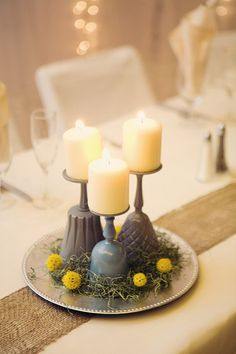 Painted drinking glasses. Replace candles with succulents or add glass to the candles so they don't drip.