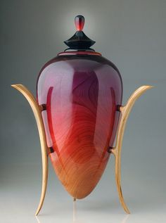 This Amaranth crimson vessel by John Popiel, is crafted from wild cherry with laminated cherry legs. The body is finished with coloured dyes and several coats of buffed lacquer. The rim is turned from bloodwood. Contemporary
