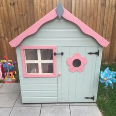 Gorgeous pink and grey playhouse perfect for introducing little ones to imaginative play! Kids Garden Playhouse, Playhouse Decor, Simple Playhouse, Outside Playhouse, Girls Playhouse, Playhouse Kits, Pallet Playhouse, Build A Playhouse, Wooden Playhouse