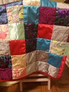 Memory quilt made from silky pajamas.  A great way to honor my mother's spirit. First I ironed on fusible interfacing, then cut my blocks to make the sewing easier.