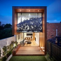 The glass wall on the rear of the home is complete with an absolutely stunning steel sheet metal façade.