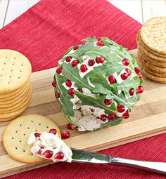 Your holiday guests will enjoy this festive and tasty cheese ball inspired by a classic holly ball! With it's sweet pomegranate seeds, salty feta cheese and peppery arugula, this easy to make yet impressive Holly Ball Cheese Ball is sure to please every guest's palate. #sponsored by @krogerco #InspiredGathering
