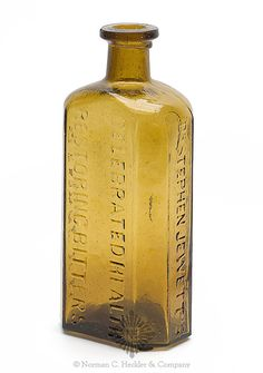 """Dr. Stephen Jewett's / Celebrated Health / Restoring Bitters / Rindge, N.H."" Bitters Bottle, a Stoddard glasshouse, Stoddard, New Hampshire, 1840-1860. Rectangular with beveled corners, brilliant olive yellow, applied square collared mouth - pontil scar, ht. 7 1/4 inches; ( some minor exterior wear). R/H #J-37 A beautiful and light color. Fine condition. #Bottles #Bitters #MADonC"