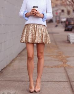 #gold sparkly skirt paired with white knit sweater