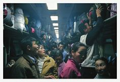 Migrant rural workers on a fully packed train on their way home, Guangdong Province//Andreas Seibert - From Somewhere to Nowhere - China's Internal Migrants