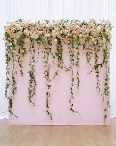 The lush floral backdrop adds glamour and romance to a indoor wedding ceremony. The lush floral backdrop adds glamour and romance to a indoor wedding ceremony. Mod Wedding, Wedding Day, Trendy Wedding, Wedding Table, Wedding Photos, Party Photos, Wedding Signs, Wedding Themes, Wedding Venues