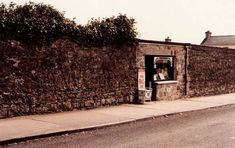 A shop in the wall, Ballina, Co. Mayo, Ireland. I remember this little shop very well, used to buy sweets here as a child.