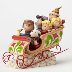 Item Number: 4052722 Material: Stone Resin Dimensions: 8.35 in H x 4.6 in W x 10.24 in L Seven of the most beloved Peanuts gang are aboard this colorful sleigh. Beautifully handcrafted, this holiday c