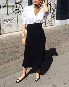 """TUCKED INTO A MIDI SKIRT  Ever wonder what """"business casual"""" actually means? This is it."""