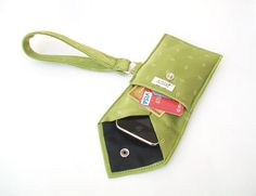 Upcycle a cool-looking silk tie into a wristlet that will hold your phone, ID, and credit card; camera and concert tickets; etc.  LOVE IT!