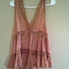 Free people copper lace paneled tank top/blouse Intimately free people tank. Silky feel. Made in india. Color in the picture is misrepresented. Color is more of a Thanksgivingy/ fall deep copper. Free People Tops Tank Tops
