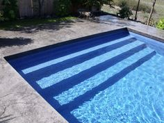 Modern Rectangle Pools Stairs that run the width of pool