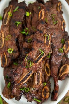 Grilled Korean Short Ribs are so tender and full of flavor! Marinated in a tangy Kalbi style marinade for hours, this juicy short rib recipe is a sure hit! Kalbi Short Ribs, Grilled Short Ribs, Korean Short Ribs, Rib Recipes, Grilling Recipes, Asian Recipes, Cooking Recipes, Asian Desserts, Smoker Recipes