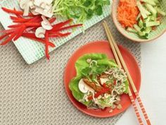 Noodle-Bowl Lettuce Wraps : This twist on a Vietnamese noodle bowl tucks vegetables, charred pork loin and ramen noodles into a lettuce leaf for sweet-savory bites that are way more satisfying than a salad. Pick up pre-cut and trimmed vegetables from a salad bar-almost any variety will work-for a dinner that comes together in minutes.