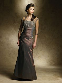 MON CHERI R2858  The Mon Cheri R2858 style dress is perfect for events requiring a evening dress..COLOR: Cocoa - SIZE: 10 -- FAST SHIP