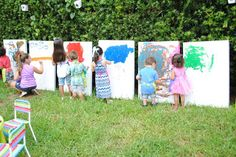 """boards along the hedge were cardboard boxes that would be serving as easels for the kids to paint."""