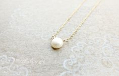 Every girl should have a pearl necklace. This is a timeless necklace featuring a petite 7mm flat coin pearl is strung on a fine 14k gold-filled chain.