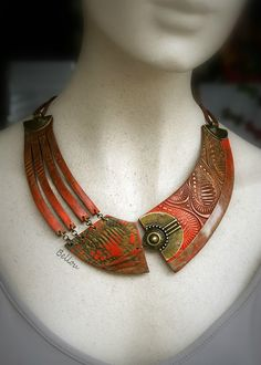 """French designer behind Bellou excels at asymmetrical polymer clay necklaces.   Each piece is one of a kind. Her imagination knows no bounds.  She uses different approaches including textures, mica shift and even a combination of mica shift and crackled techniques which she called """"micacrak"""" over on her blog."""