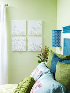 Use cupcake liners, watercolors and canvases to create custom artwork. More DIY bedroom makeover: http://www.bhg.com/rooms/bedroom/makeovers/diy-bedroom-makeover/?socsrc=bhgpin052113cupcakelinerDIY=11