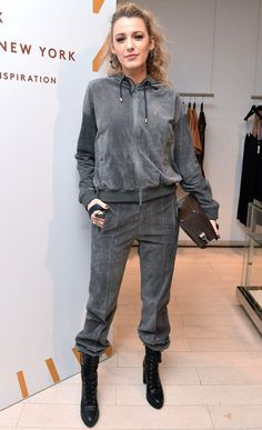 Blake Lively in a gray tracksuit and lace-up boots
