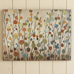 Cool art-canvas with painted stems and punched out circles from paint samples!