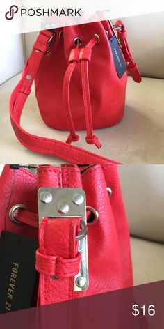 "NWT Red Faux Leather Crossbody bucket bag NWT Red Faux leather crossbody bucket bag. Cute bucket bag featuring a drawstring top with silver polished grommet accents,  crossbody strap and a flat bottom. No interior zips or compartments. Size + Fit - Height: 8"" - Width: 8"" - Depth: 4.5"" Forever 21 Bags Crossbody Bags"
