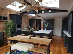Pitch pine kitchen floor with contrasting slate blue kitchen units