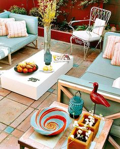 We have the basics down for our new patio (furniture and pillows), but this year I want to entertain with some style and add color.
