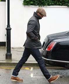 Cap. Wax jacket with elbow patches. Jeans. Shoes. Yes, it's Mr Beckham.