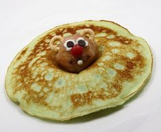 Groundhog Pancakes - Use a donut hole for head, Cheerios for ears, use white icing and mini chocolate chips for eyes, mini red M & M nose. How cute is this?!