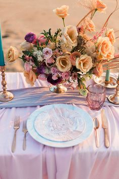 Colorful Beach Sunset Bridal Shoot Elegant bouquet centerpiece with silk table runners and chiffon table linens Sunset Beach Weddings, Beach Wedding Colors, Beach Wedding Decorations, Wedding Centerpieces, Sunset Wedding, Wedding Reception Design, Wedding Set, Wedding Tips, Boho Wedding