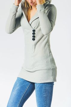 I like this this is a fitted sweater and is a little different, with the buttons and the collar