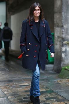 Emmanuelle Alt in a blue coat with red accents. #streetstyle at Paris Fashion Week Fall 2014 #PFW