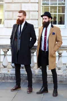 Opt for a camel overcoat and black slim jeans to look classy but not particularly formal. Black leather boots are a good choice to complete the look.  Shop this look for $356:  http://lookastic.com/men/looks/hat-dress-shirt-pocket-square-tie-boots-skinny-jeans-overcoat-suspenders-blazer/5995  — Black Wool Hat  — White Dress Shirt  — Navy Print Pocket Square  — Purple Print Tie  — Black Leather Boots  — Black Skinny Jeans  — Camel Overcoat  — Brown Suspenders  — Navy Blazer