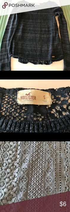 HOLLISTER NAVY BLOUSE-SWEATER Good used condition. Size small from a non-smoking home. In my opinion, this could easily fit a medium. There is embroidery type fabric on the back of the sweater/blouse. Please refer to photos for details. Hollister Tops Blouses