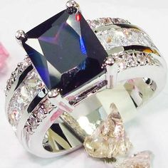 Princess Cut Amethyst ring set in a Sterling Silver setting. The ring has gorgeous Austrian Crystals all around it