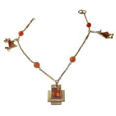 Cartier Citrine Diamond Gold Charm Bracelet circa 1950 | From a unique collection of vintage chain bracelets at https://www.1stdibs.com/jewelry/bracelets/chain-bracelets/