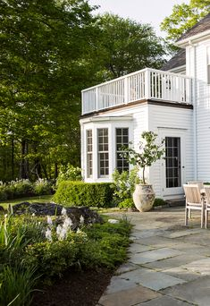 Classic clapboard exterior and bay window under the balcony.