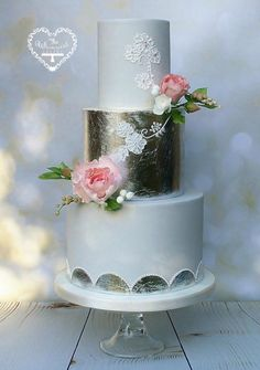 Silver Leaf and Hand Piped Wedding Cake by The Whimsical Cakery - http://cakesdecor.com/cakes/225355-silver-leaf-and-hand-piped-wedding-cake
