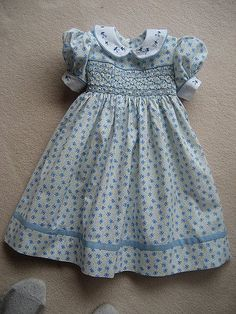 Smocked dress with embroidered and piped collar This would be a great technique to lengthen the hem with a contrast strong. Need to remember to save and label hem fabric. Girls Smocked Dresses, Little Girl Outfits, Little Girl Dresses, Cute Dresses, Kids Outfits, Smocked Dresses For Toddlers, Smocked Baby Clothes, Vestidos Vintage, Smock Dress