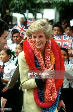 NOVEMBER 08: Diana, Princess of Wales is presented with garlands on a visit to Has Tamar, a British Forces shore base, during her official visit to Hong Kong on November 8, 1989 in Hong Kong