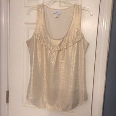 Iridescent sleevless top Has some gold tones sleevless top by the loft. Ruffle around neckline. Pretty for a night out! LOFT Tops Blouses