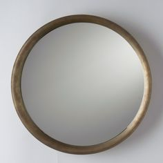 The Higgins Mirror features smooth, elegant lines with a round shape, curved rim and pencil-polished edges. Comes with keyhole hanger for easy wall mounting. Hand assembled in our Portland, Oregon Schoolhouse factory. Natural Brass finish. A Schoolhouse Exclusive.  This item is Temporarily Sold Out.