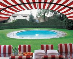 Gorgeous! Love the simple pool decking of stone, adore the way the hedges are sculpted and those stripes are yummy!