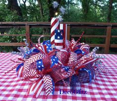 This patriotic table centerpiece will be perfect for your Fourth of July celebration! It features lots of red, white and blue in addition to sparkly firecrackers! It is 22 in diameter and 17 tall. Fourth Of July Decor, 4th Of July Decorations, 4th Of July Party, July 4th, 4th Of July Wreath, Patriotic Crafts, July Crafts, Holiday Crafts, Diy And Crafts